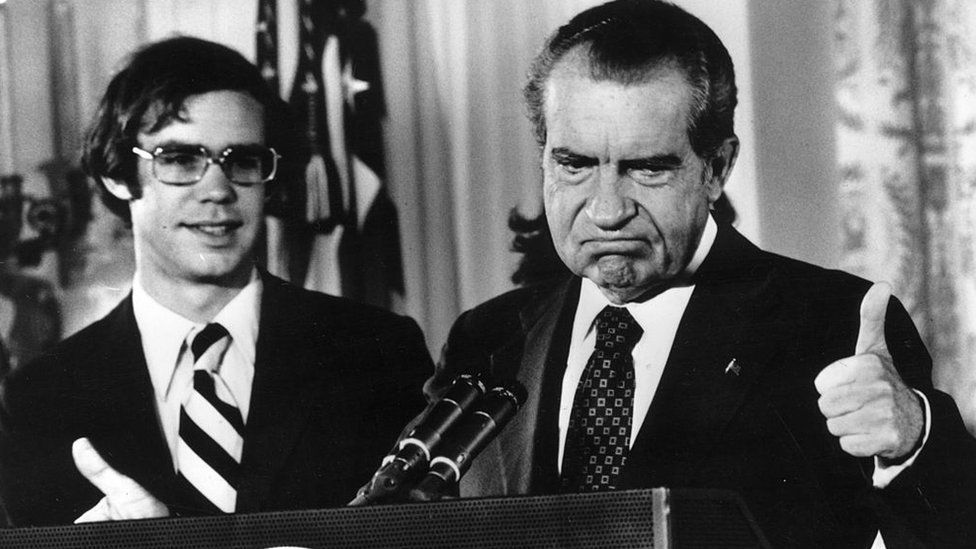 Richard Nixon gives the thumbs up after his resignation as 37th President of the United States