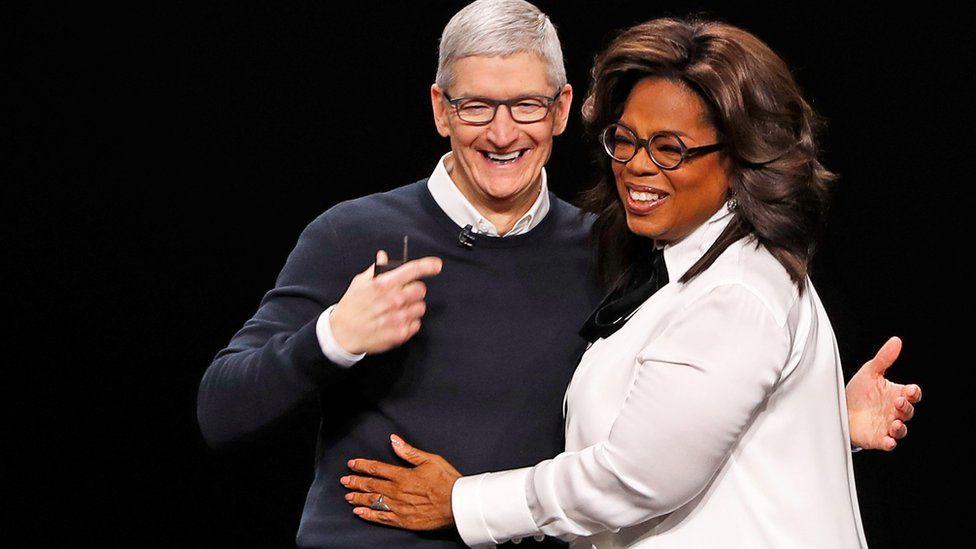 Apple chief executive Tim Cook and Oprah Winfrey