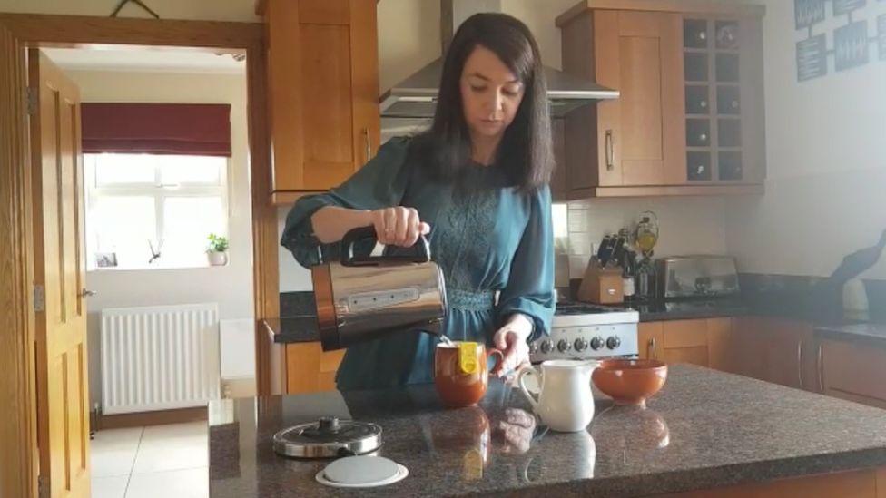 Dawn Hopper making tea