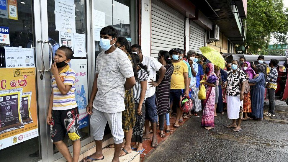 Long queue seen outside a government-run supermarket in Colombo