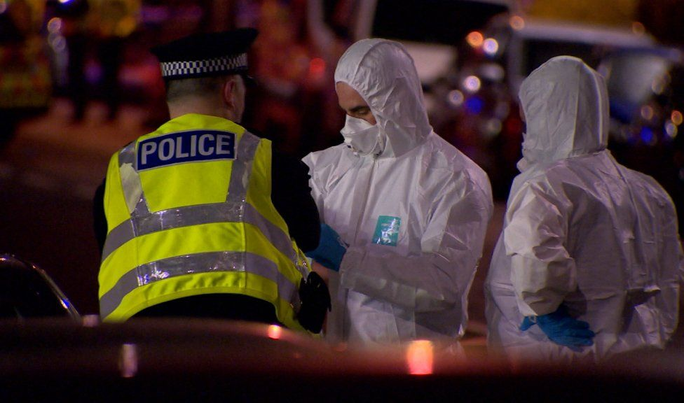 Uniformed officers and forensic specialists worked through the night
