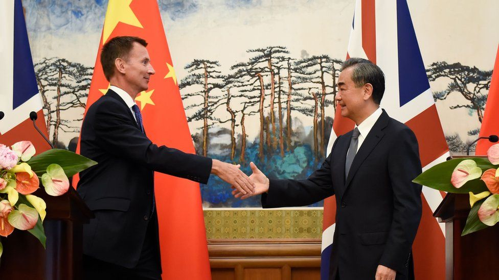 Britain's Foreign Secretary Jeremy Hunt (L) shakes hands with China's Foreign Minister Wang Yi (R) after a press conference at the Diaoyutai State Guesthouse in Beijing on July 30, 2018