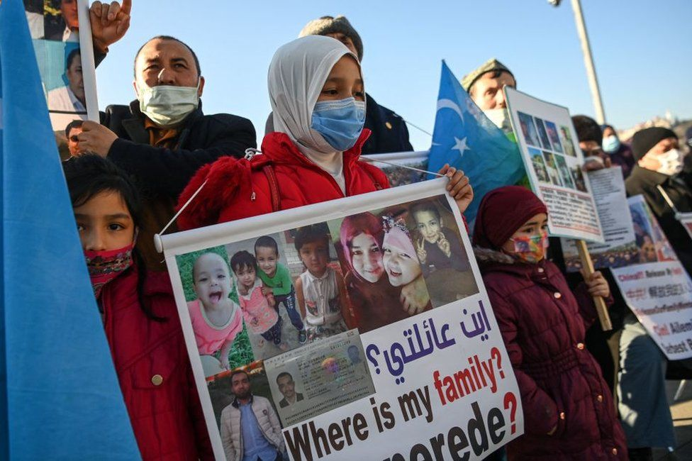 Members of Uighur minority hold placards as they demonstrate on February 22, 2021 near China consulate in Istanbul