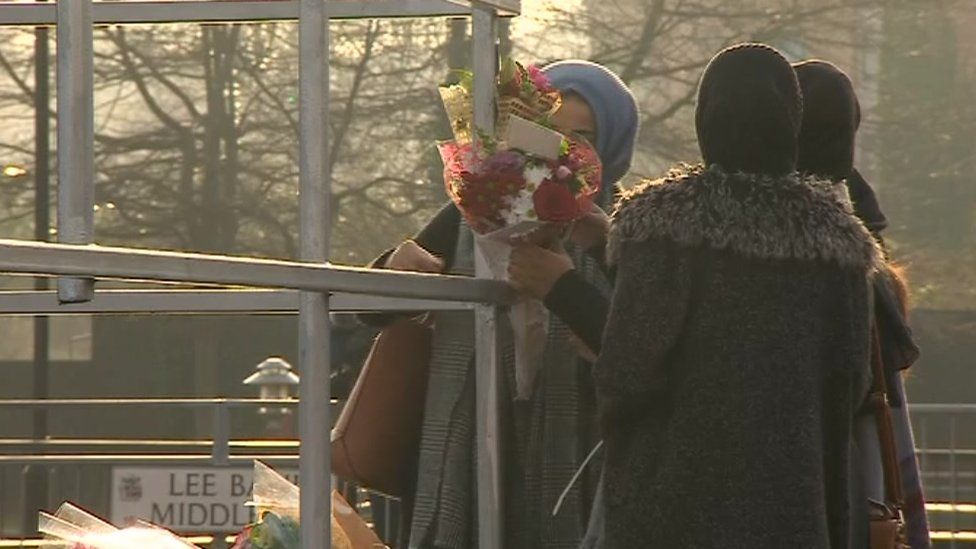 Women leave tributes at the scene of the crash on Belgrave Middleway