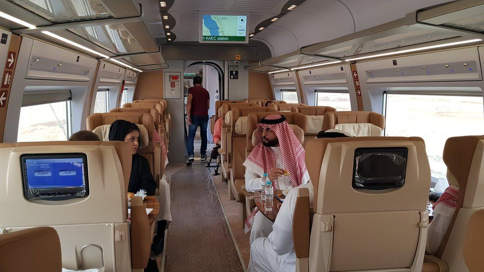 Saudis sit inside a new high-speed Haramain Express train in Jeddah, Saudi Arabia (18 September 2018)