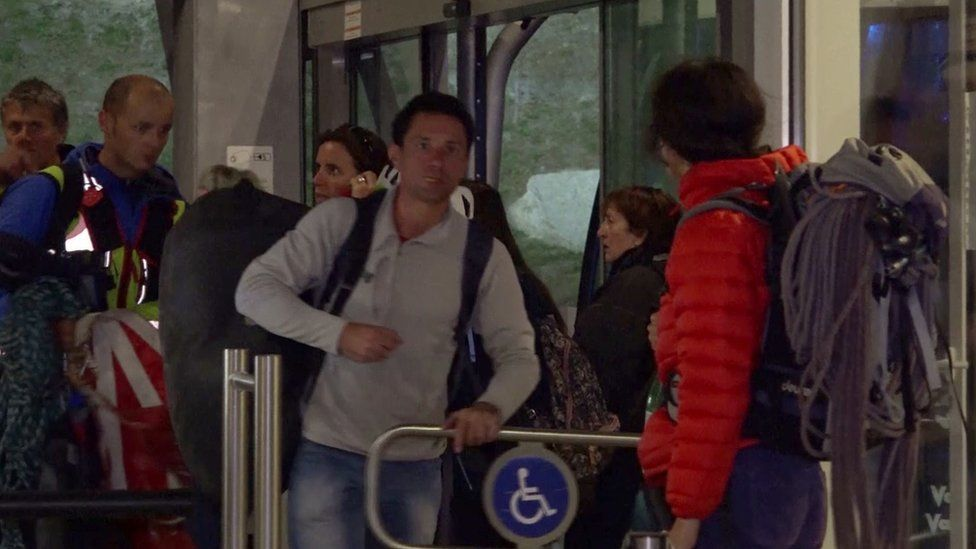 Video image shows rescued passengers arriving at a cable car station in Courmayeur, Italy. 8 Sept 2016