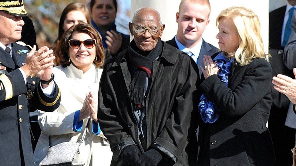 Richard Overton (C) is acknowledged by US President Barack Obama (not pictured) during a ceremony to honour veterans at Arlington National Cemetery in Arlington, Virginia, on 11 November 2013