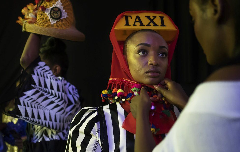 Models get ready backstage prior to walk down the runway at the Hub of Africa, Addis Fashion Week in Addis Ababa, on October 03, 2018