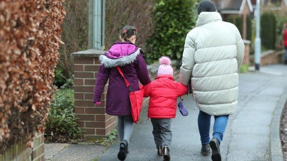 Schoolchildren make their way to primary school
