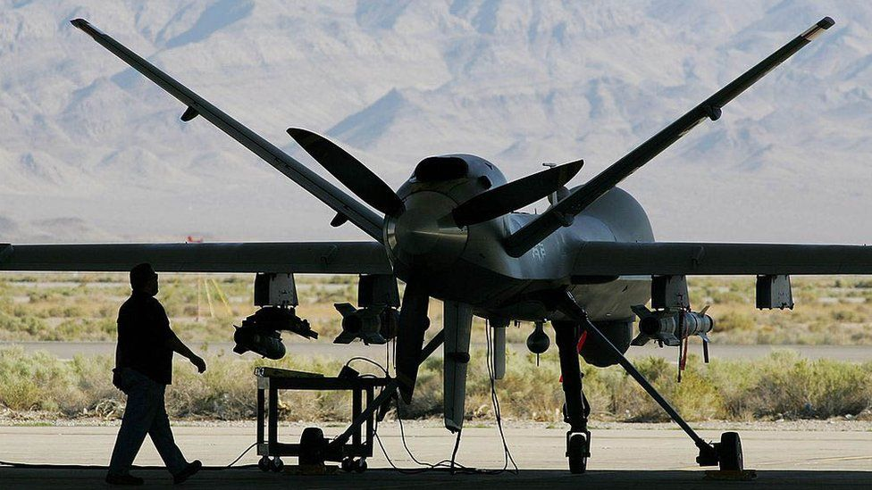 An engineer inspects an MQ-9 Reaper drone at Creech US Air Force Base