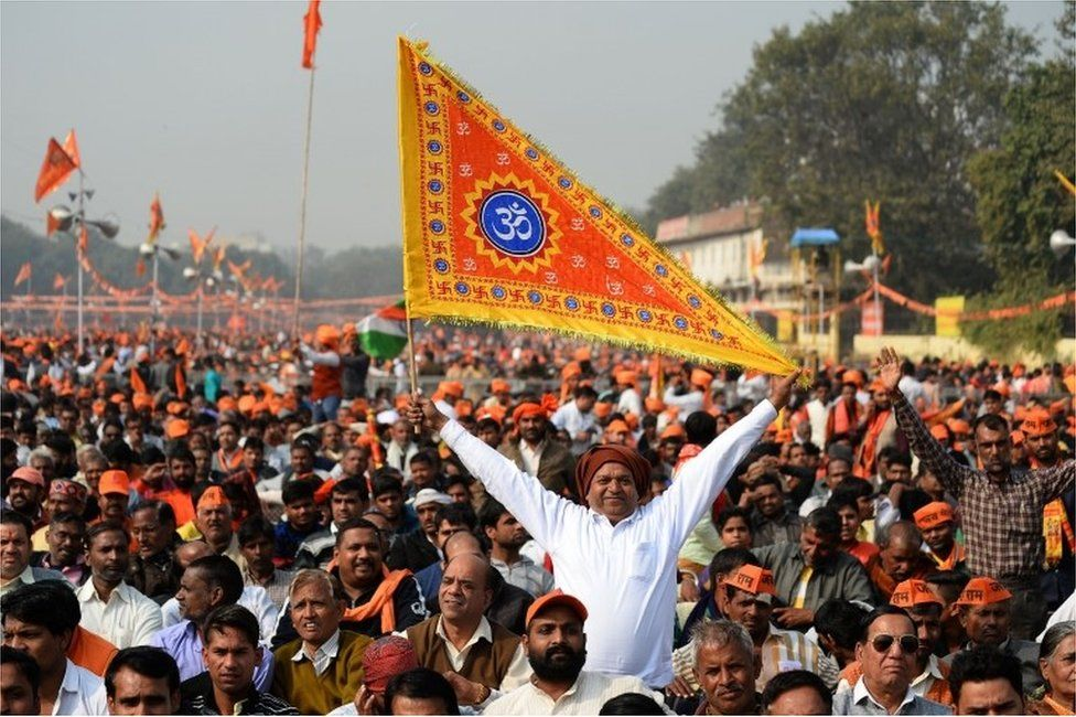 An Indian Hindu hardliner holds a religious flag as he participates in a rally calling for the construction of a temple on the site of the demolished 16th century Babri mosque, located in Ayodhya, in New Delhi on December 9, 2018.