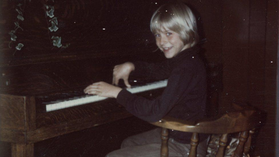 The collection includes this photo of Kurt, aged eight, playing the piano