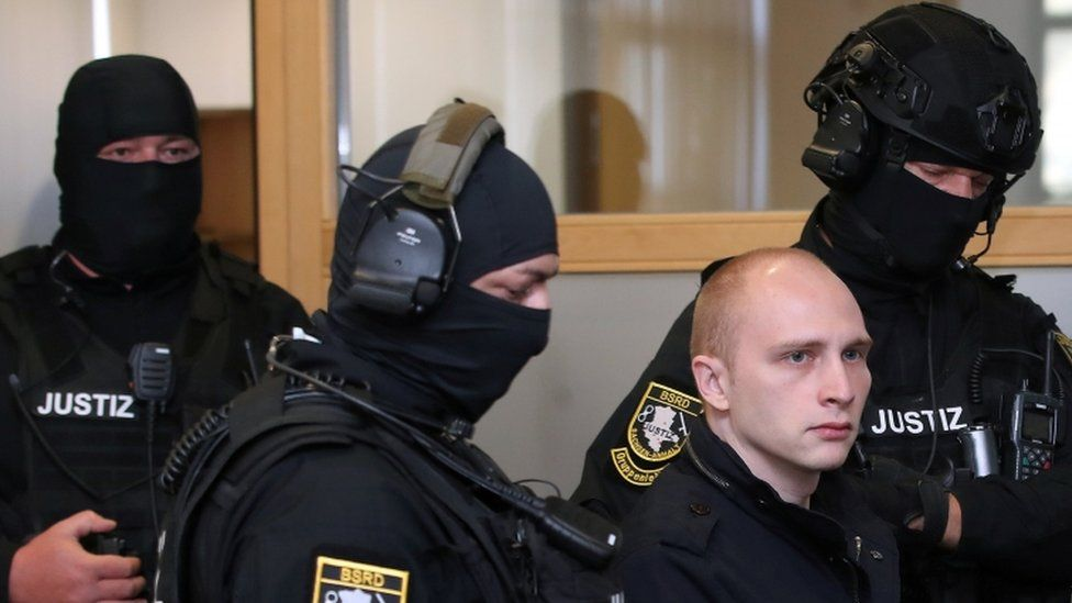 Stephan B., accused of shooting two people after an attempt to storm a synagogue in Halle, arrives for the start of his trial at a local court in Magdeburg, Germany, July 29, 2020