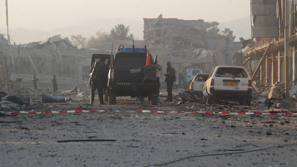 Afghan security officials inspect the scene of multiple suicide bombing that targeted the German consulate in Mazar-e-Sharif, Afghanistan, 11 November 2016.