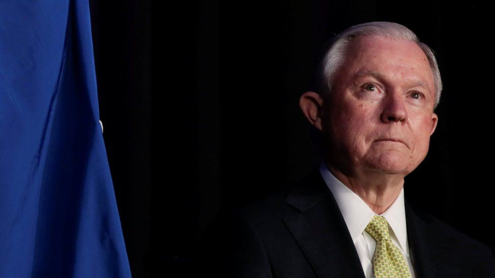 Attorney General Jeff Sessions waits to make an address