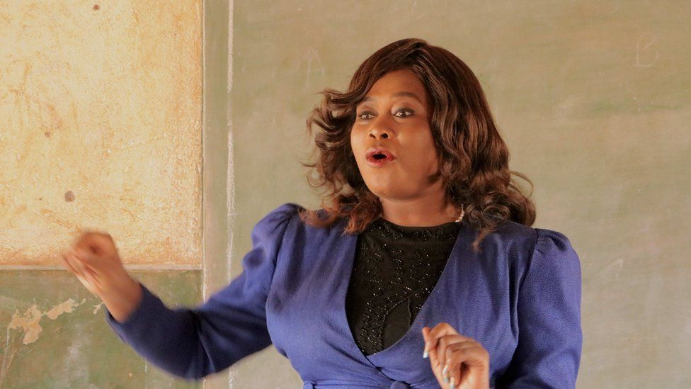 natasha talks to girl children at a public school in the capital lilongwe