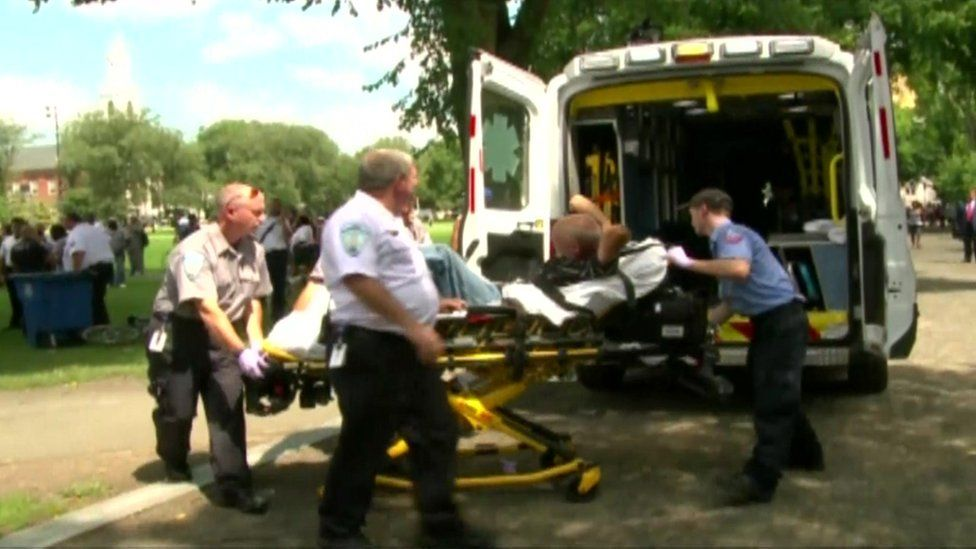 Emergency crews escort a victim to an ambulance in New Haven, Connecticut.