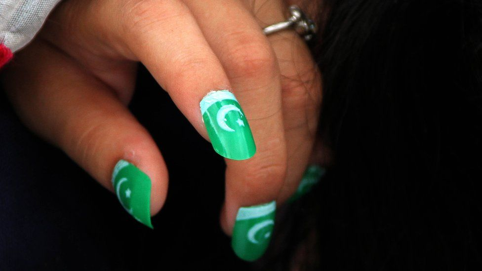 Pakistani girls wears artificial nails in colours of national flag during a ceremony at the mausoleum of founder of Pakistan, Muhammad Ali Jinnah, as national celebrates the Independence Day, in Karachi, Pakistan, 14 August 2017
