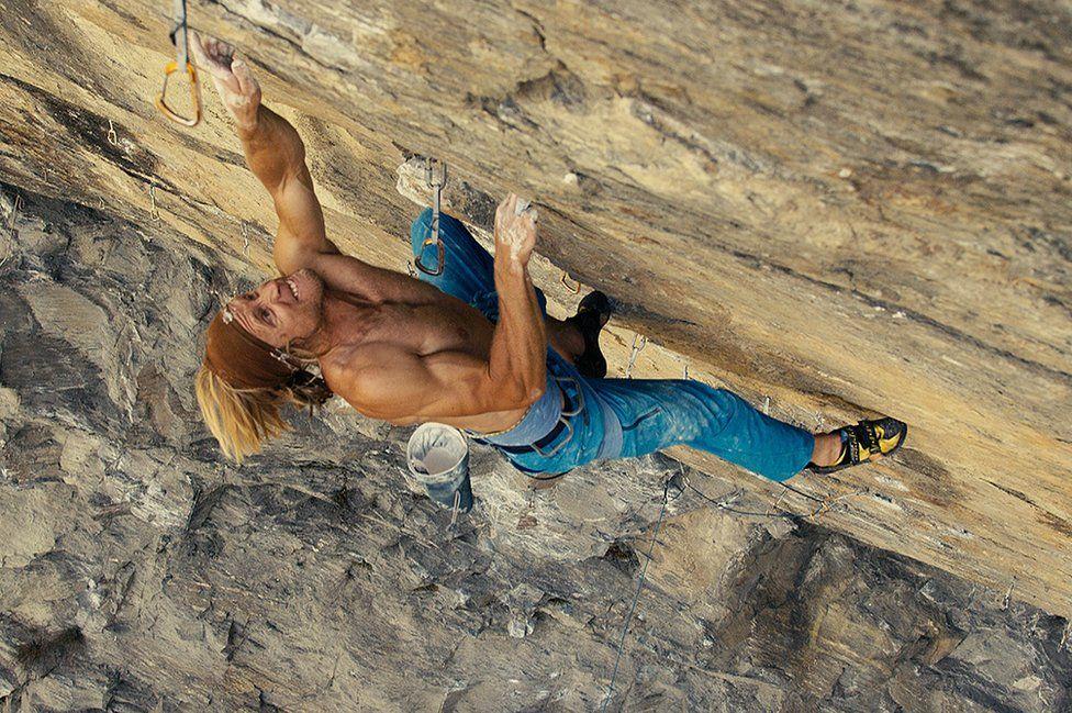 Matt Helliker in climbing action