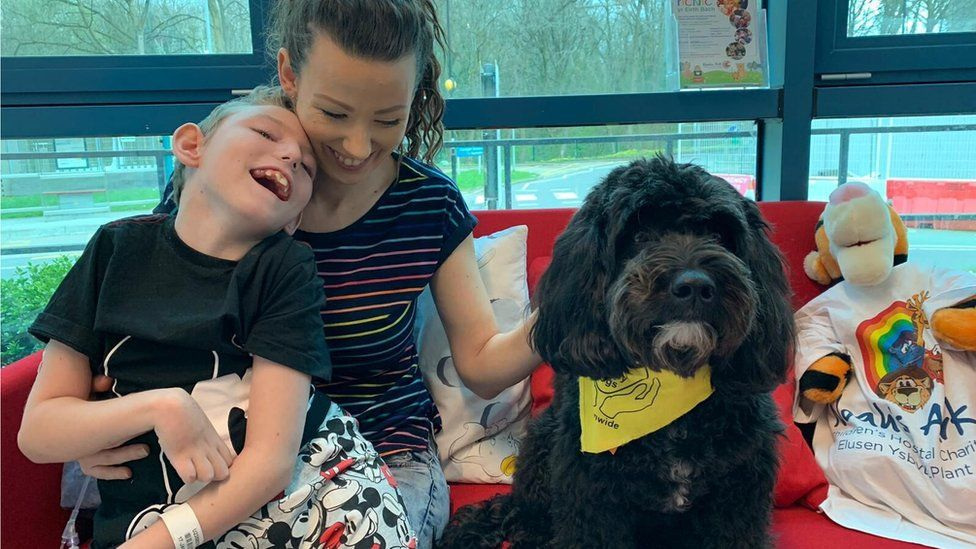 Harvey Hawkins with his mum Jamie-Louise Wallace and Nico the dog