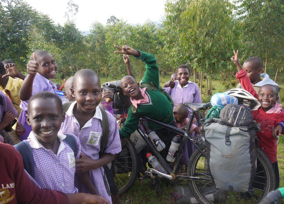 Schoolchildren in Uganda mucking about with Stephen's bike
