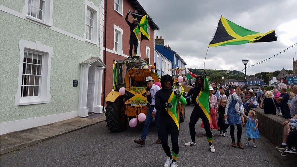 Men blacked up as the Jamaican bobsleigh team at Aberaeron carnival