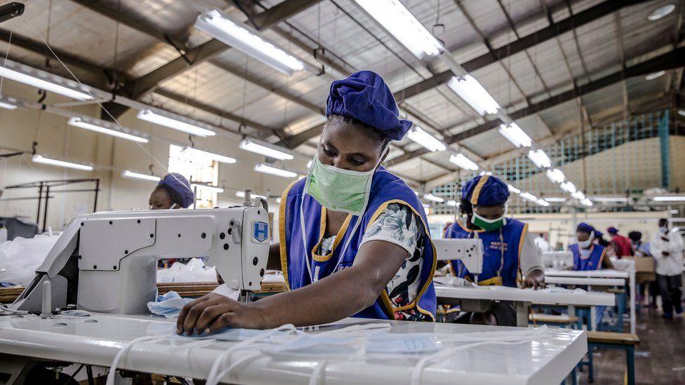 A worker produces face masks at KICOTEC in Kitui, Kenya on April 7, 2020.