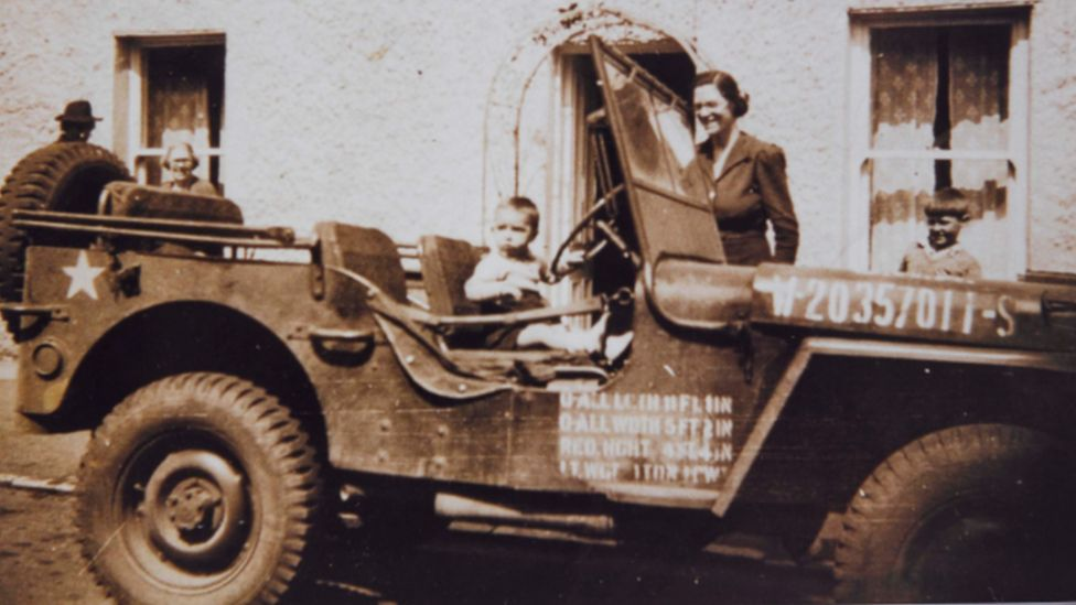 Child in US jeep