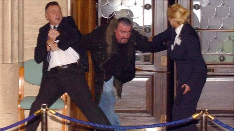 Michael Stone being restrained during the attack at Stormont in 2006