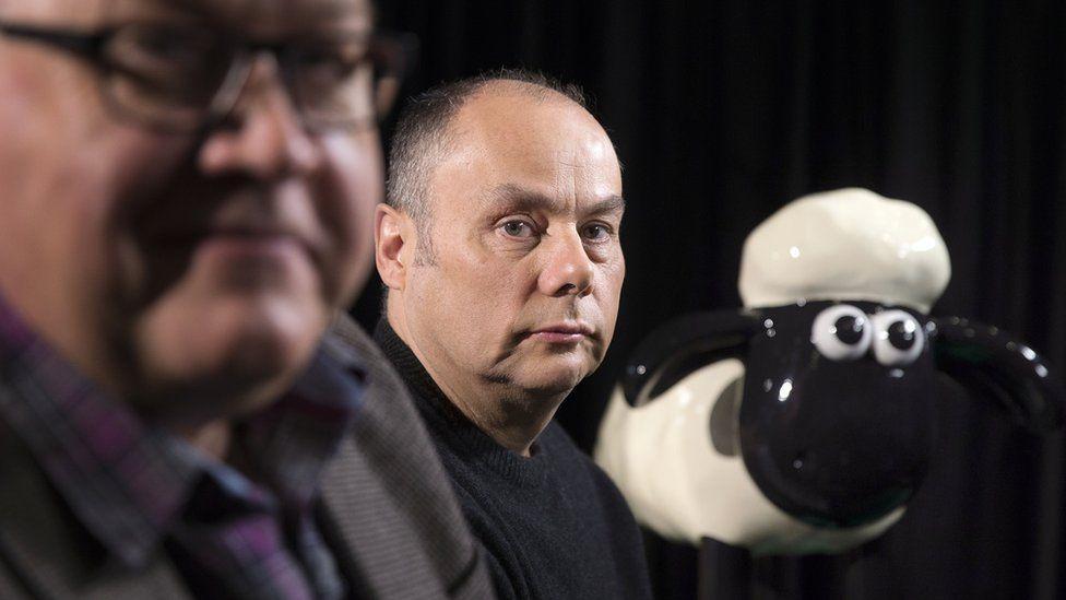Richard Goleszowski (L) and Mark Burton of Aardman Animations with Shaun the Sheep figure
