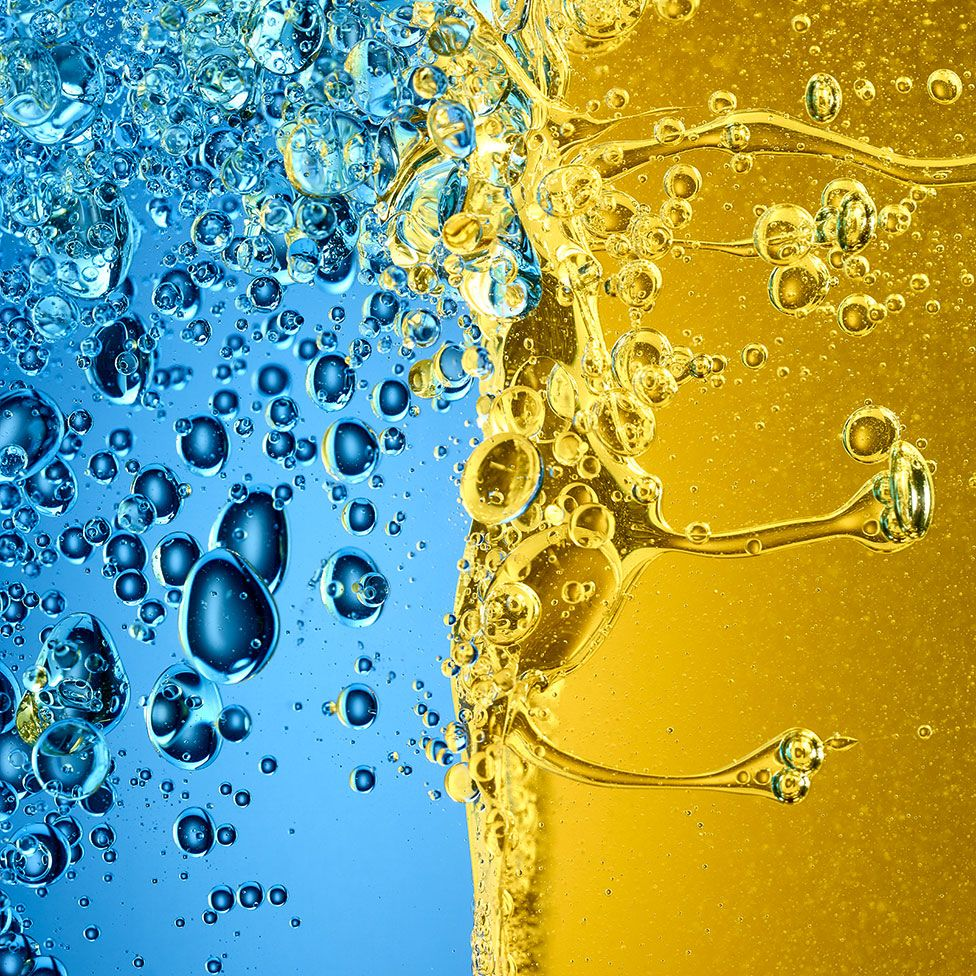 Close up image of oil and vinegar mixing together