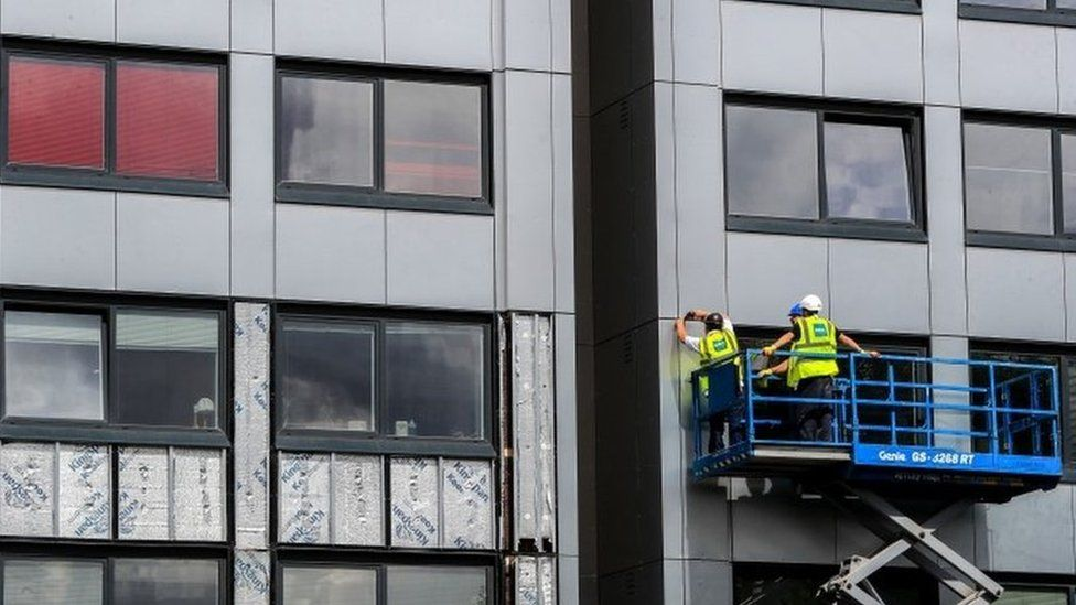 Cladding being removed from a tower block in Manchester in 2017