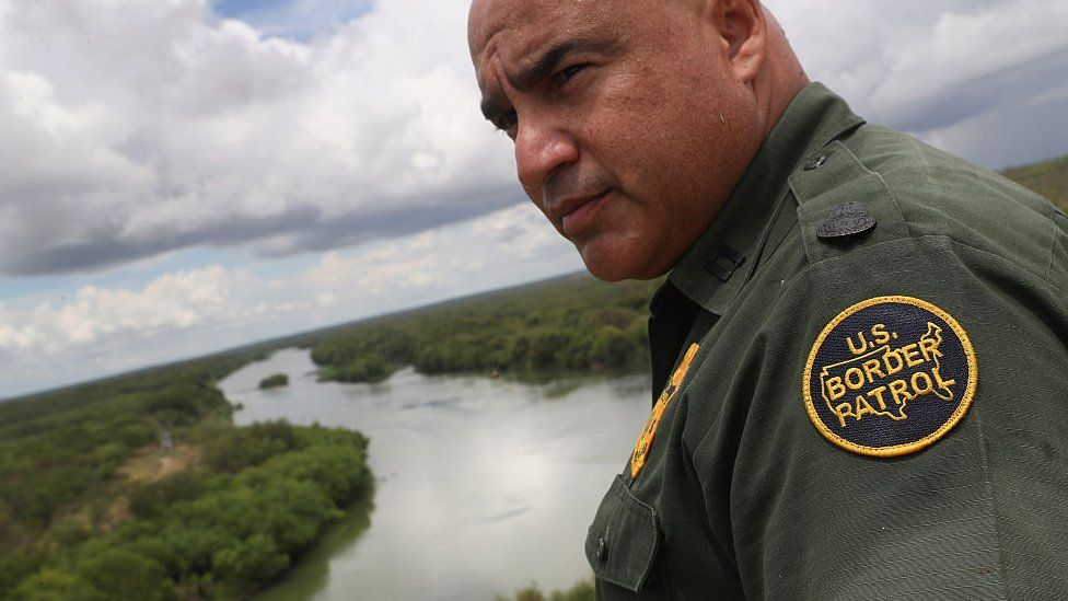 US Border Patrol agent Jose Perales looks into Mexico from the US-Mexico border at the Rio Grande on near Roma, Texas. Republican Presidential candidate Donald Trump has promised to build a wall, at Mexico's expense.