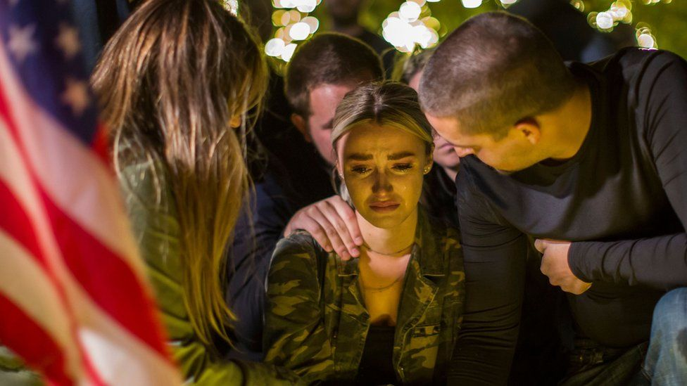 A woman cries during a vigil to pay tribute to the victims of a shooting in Thousand Oaks, California