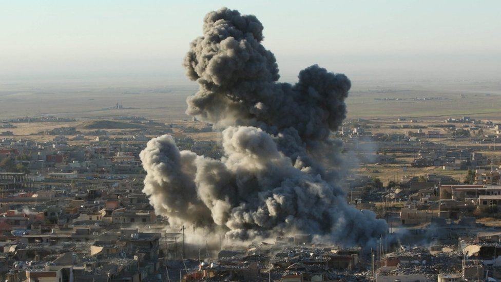 Smoke rises from the site of US-led coalition air strikes in the town of Sinjar, 12 November 2015