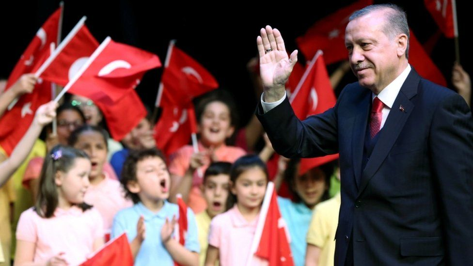 Turkish President Tayyip Erdogan waves during a ceremony at the Presidential Palace in Ankara on 23 April, 2017