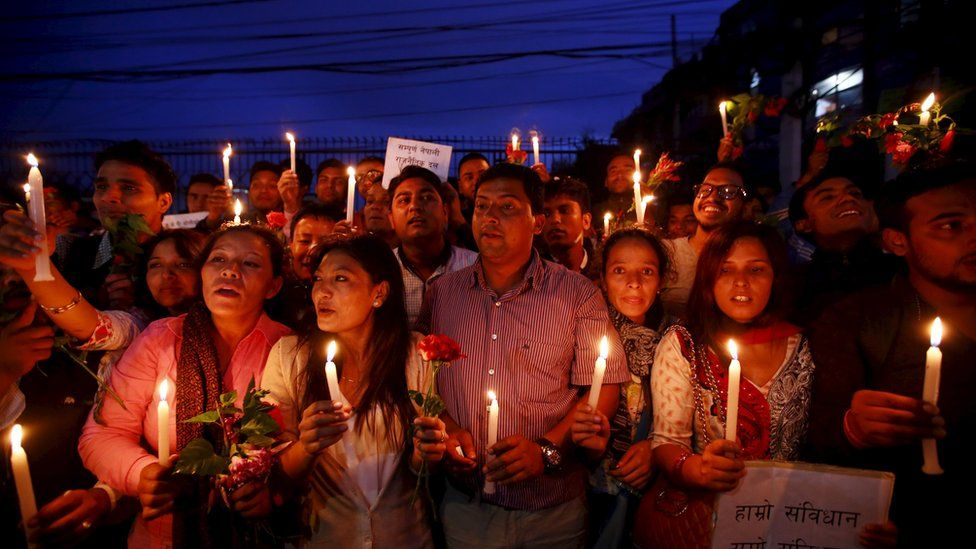 Nepalese students celebrate as they take part in the candlelight vigil welcoming the new constitution in Kathmandu, Nepal September 17, 2015