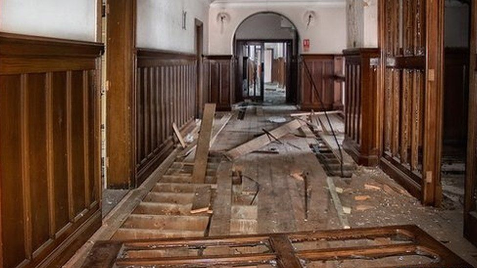 Ripped floorboards inside Ipswich's County Hall