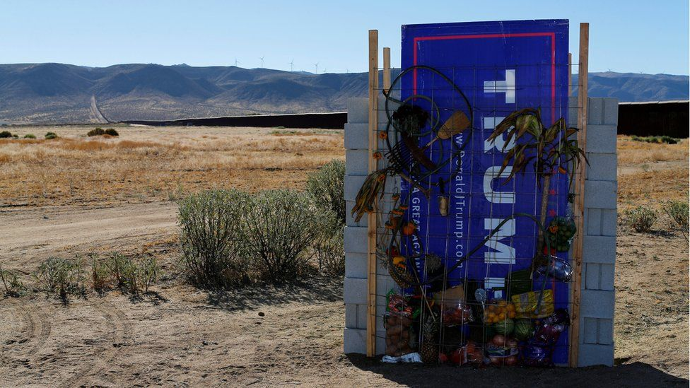 """A version of Republican presidential candidate Donald Trump""""s wall created by artists David Gleeson and Mary Mihelic is pictured next to the U.S. Mexican border in Jacumba Hot Springs"""
