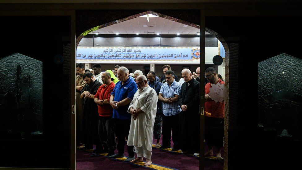 Mourners praying at a mosque in Sydney the morning after the Christchurch shootings