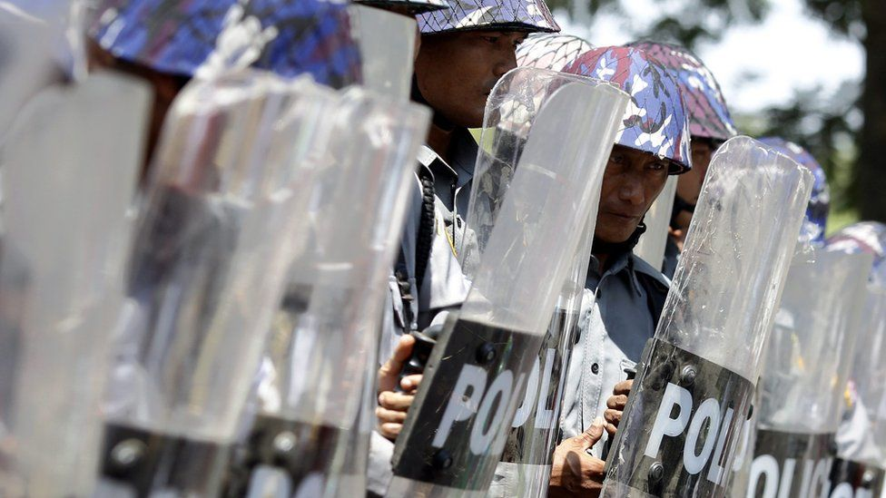 """Riot police officer stand in line as they block the road to stop a protesters"""" march demanding labor rights in TetKone, near Naypyidaw, Myanmar, 18 May 2016."""