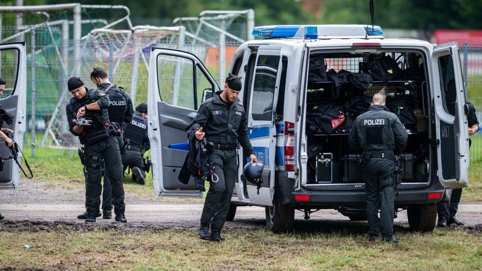 Armed police officers are seen during the ongoing manhunt for fugitive Yves Rausch