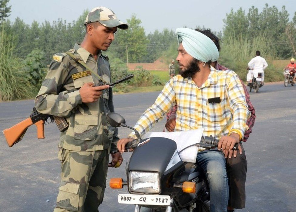 Indian Border Security Force (BSF) personnel do a security check near the India-Pakistan Wagah Border, about 35 kms from Amritsar on September 29, 2016, a
