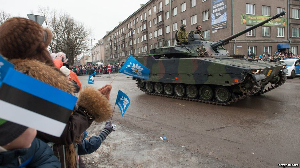 Spectators watch a tank during a parade as part of an event to celebrate 97 years since first achieving independence in 1918 in February 2015 in Narva, Estonia.