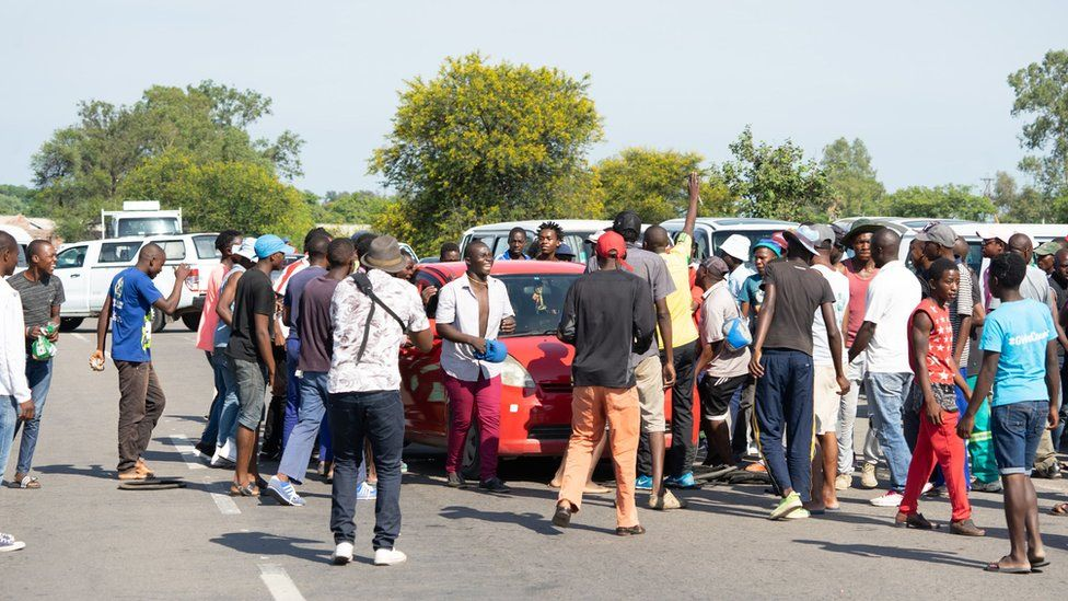 Protesters in Bulawayo block the road leading to the city demonstration