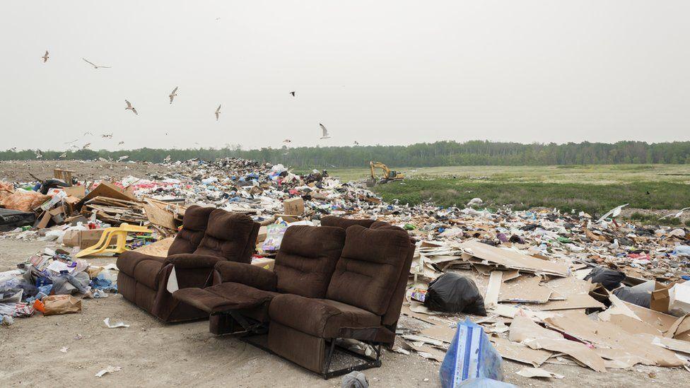 Old sofa in landfill