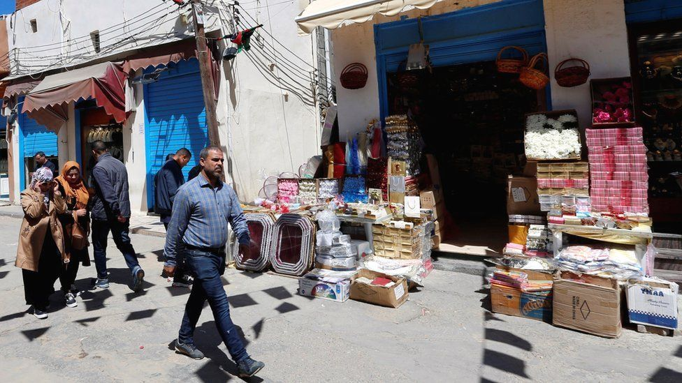 People walk at a market in the old city of Tripoli, Libya - 6 April 2019