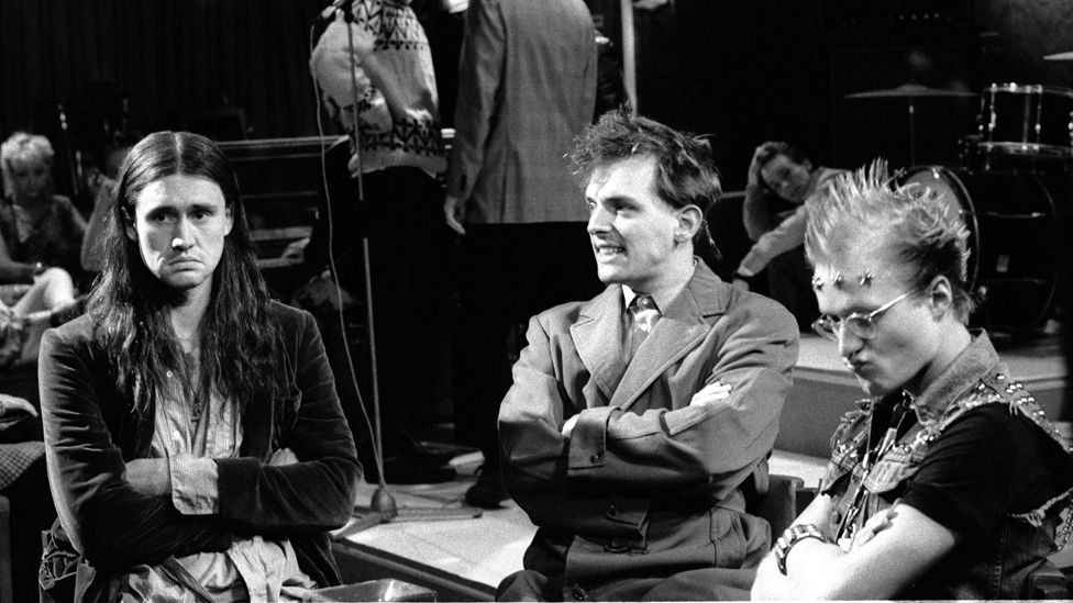 Nigel Planer, Rik Mayall and Adrian Edmondson (r) on set during the filming of The Young Ones in 1982