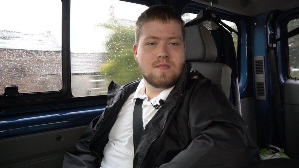 Christopher sat in the van on the way to school.