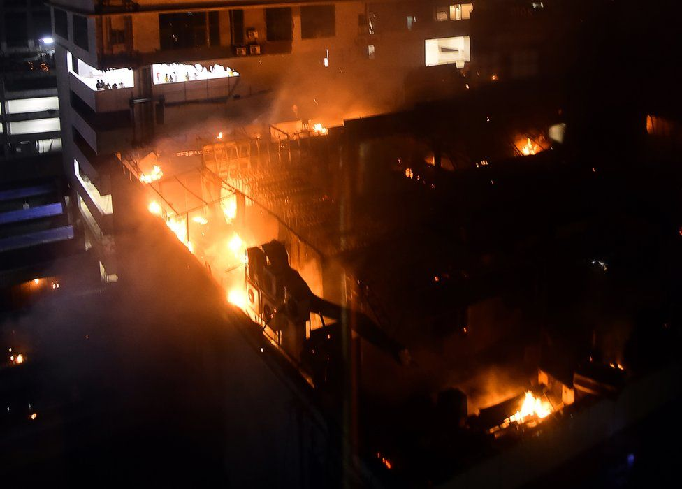 A view of a building on fire where a rooftop party was being held in Mumbai early on 29 December 2017.